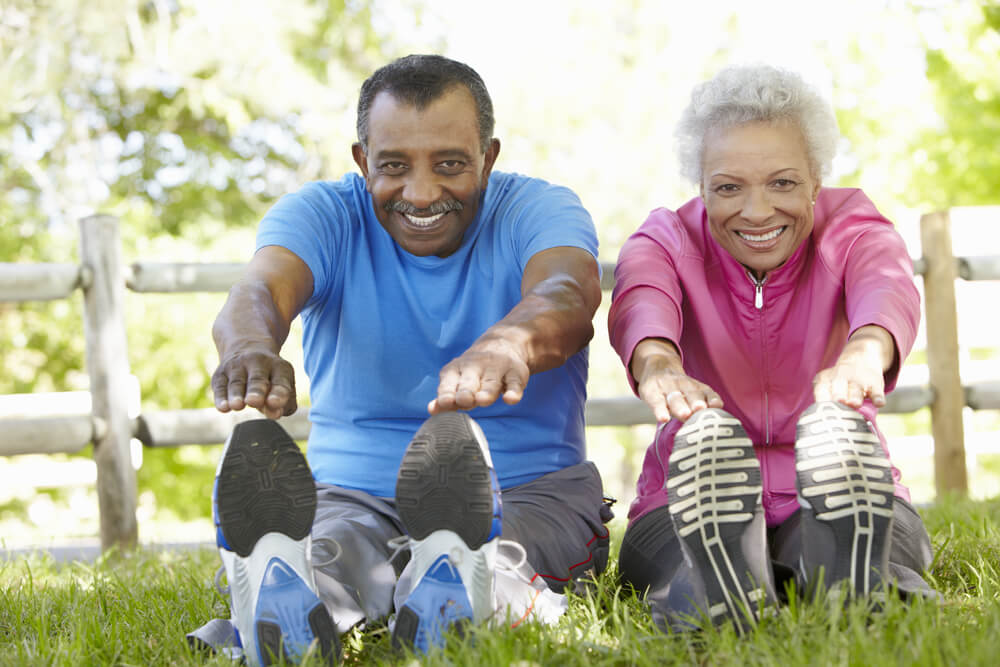 Elderly couple streching outside